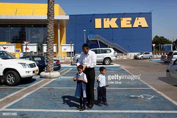 Israelis stand in the car park outside Swedish retail giant IKEA on August 24 2009 in the coastal city of Netanya north of Tel Aviv Swedish newspaper...