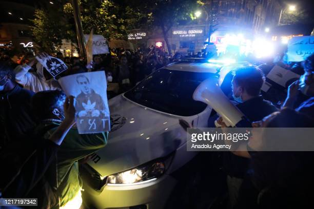 Israelis surround a police car during a protest against the shooting dead of Eyad El-Hallaq, a 32-year-old mentally disabled Palestinian, by Israeli...