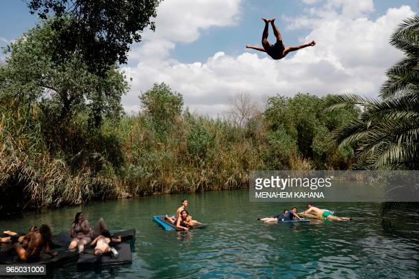Israelis swim in a spring water lake in the Israeli kibbutz of Ein Hanatziv south of the town of Beit Shean in the Jordan valley on May 31 2018