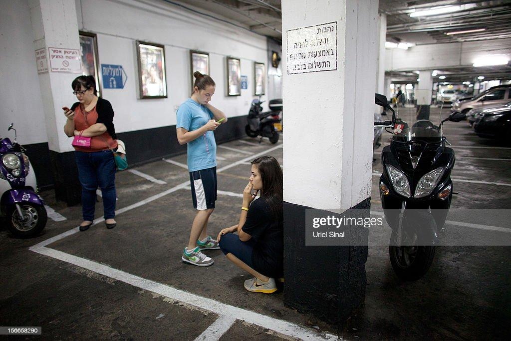 Israelis take cover at a shopping centre parking garage during a rocket attack on November 18, 2012 in Tel Aviv, Israel. At least 53 Palestinians and three Israeli's have died since the conflict began five days ago.
