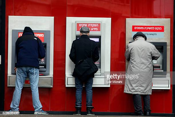 Israelis take out money from an ATM on January 11 2012 in downtown Jerusalem Israel