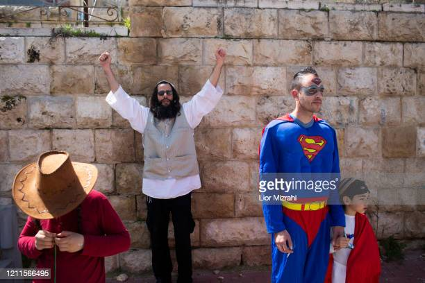 Israelis take part in a parade celebrating the Jewish holiday of Purim on March 10, 2020 in Hebron, West Bank. The carnival-like Purim holiday is...