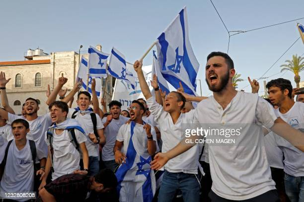 """Israelis take part in the annual Jewish nationalist """"Jerusalem Day"""" march to mark the reunification of Jerusalem after Israel captured the eastern..."""