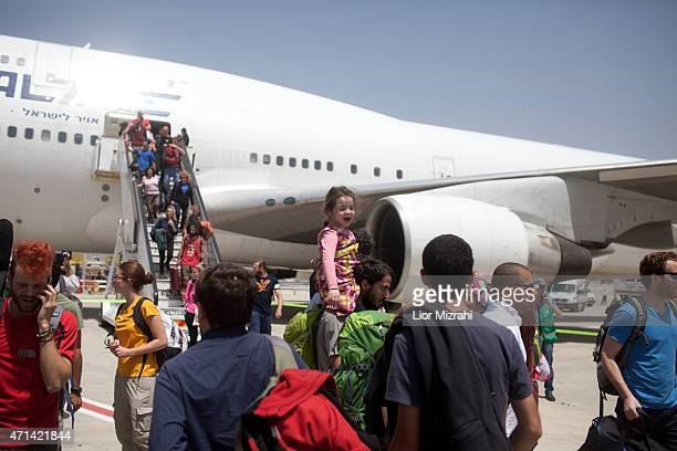 Israelis travelers from Nepal disembark from an Israeli rescue plane after it landed in Ben Gurion Airport on April 28 2015 in Tel Aviv Israel A...