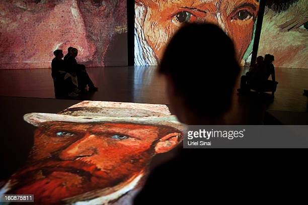 Israelis visit a multimedia art exhibition entitled Van Gogh Alive featuring the work of the painter Vincent van Gogh on February 7 2013 in Tel Aviv...