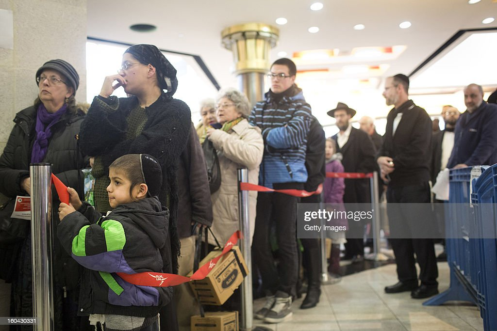 Israelis wait in a line to collect gas mask kits from a distribution station in a mall January 31, 2013, in Pisgat Ze'ev, East Jerusalem, Israel. Israel remains on high alert after the Israeli air force reportedly launched an airstrike January 30, on a convoy that Israeli officials said was carrying weapons from Syria to Lebanon on the Syria-Lebanon border.