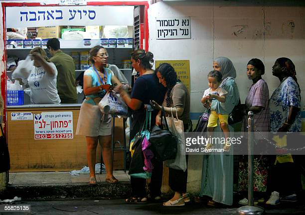 Israelis wait their turn to get food aid ahead of the Jewish New Year which begins next week from the private Pitkhon Lev charity at their...