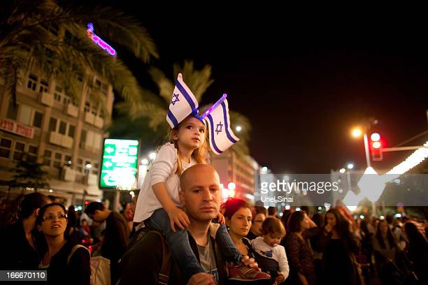 Israelis watch fireworks in the sky as Israelis celebrate the Jewish state's 65th Independence Day on April 15 2013 in Tel Aviv Israel