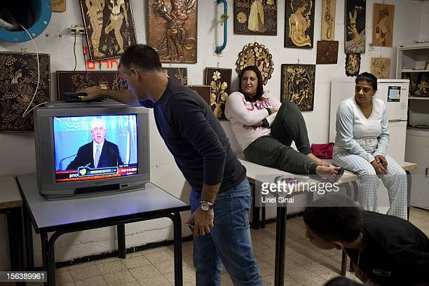Israelis watch Israeli PM Benjamin Netanyahu on TV in a bomb shelter on November 14 2012 in Netivot Israel Israel Defense Forces launched aerial...