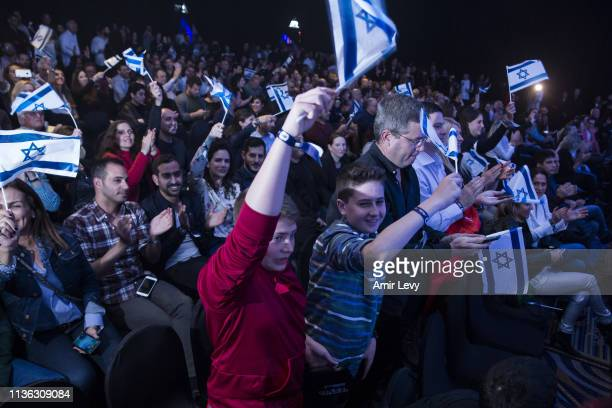 Israelis wave the Israeli flag after Beresheet spacecraft fails to land safely on the moon on April 11 2019 in Tel Aviv Israel The Israeli spacecraft...