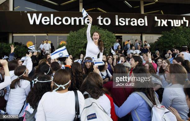 Israelis welcome new Jewish immigrants from North America upon their arrival at Ben Gurion International Airport near Tel Aviv on September 8, 2009....
