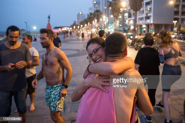 Israelis with no face mask hug as they enjoy time together at the beach on April 19, 2021 in Tel Aviv, Israel. As of April 18, Israelis could...