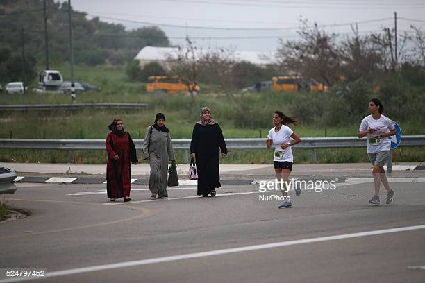 Israelis woman are running or participating in the marathon during an Israeli marathon in Easter near Al Sawia village in the west bank on April 9...