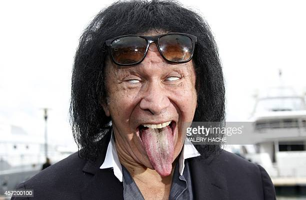 """Israeli-US actor and musician, member of the band Kiss, Gene Simmons sticks his tongue out as he poses during a photocall for the TV serie """"Gene..."""