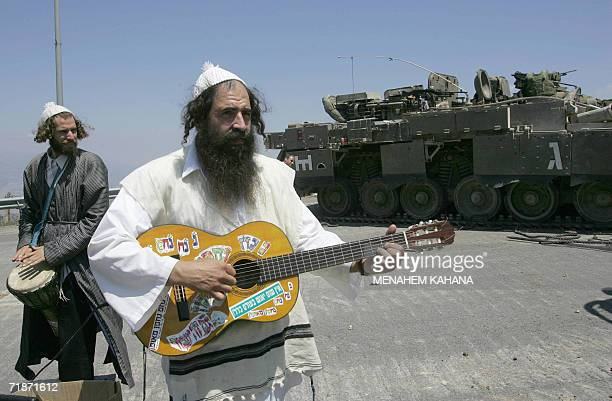 Ultra Orthodox Jews play music to amuse Israeli troops delayed on the Israeli border with Lebanon 01 August 2006 Prime Minister Ehud Olmert said...