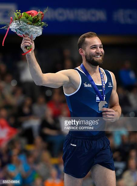 Israels Alexander Shatilov celebrates on the podium after the Mens Floor competition of the European Artistic Gymnastics Championships 2016 in Bern...