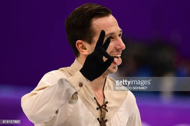 Israel's Alexei Bychenko reacts after competing in the men's single skating free skating of the figure skating event during the Pyeongchang 2018...