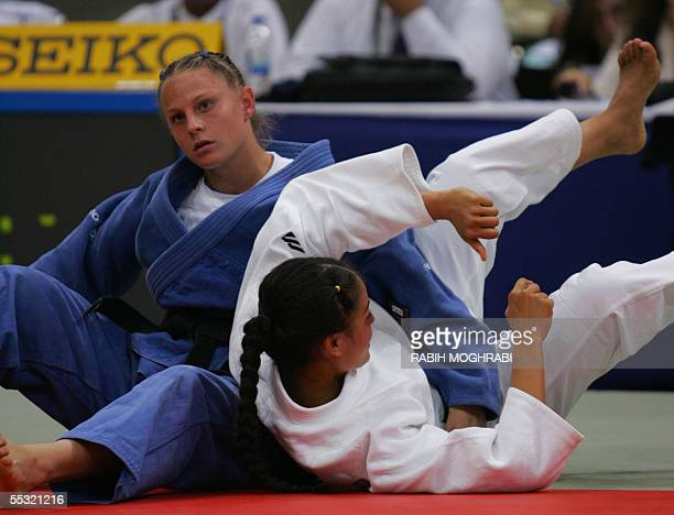 Israel's Alice Schlesinger fights with Silulu Etonu of American Samoa during their 63kg women class match at the World Judo Championships in Cairo 09...
