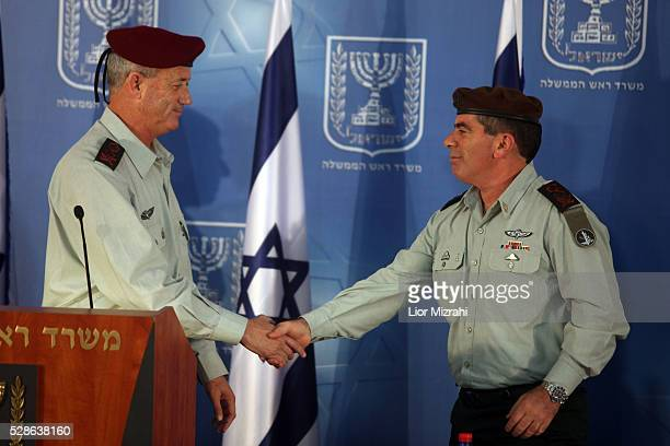Israel's Army 20th Chief of Staff Benny Gantz shake hands with outgoing Chief of Staff Gabi Ashkenazi during a special ceremony at the Prime...