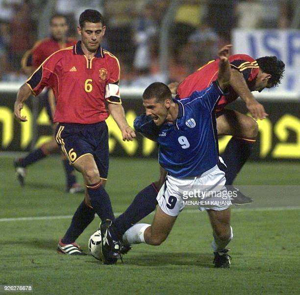 Israel's Avi Nimny challenges Spain's Miguel Angel Nadal and Hierro Ruiz during their group 7 World Cup 2002 qualifying match in Ramat Gan 06 June...