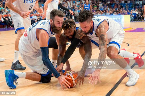 Israel's center Richard Howell vies for the ball with Italy's point guard Daniel Hackett and point guard Andrea Cinciarini during the FIBA EuroBasket...