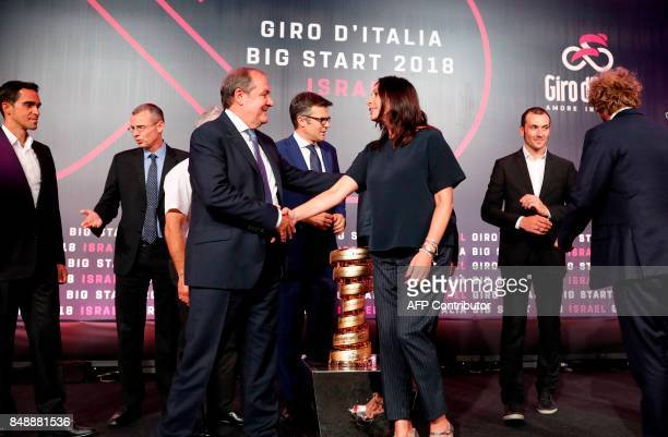 Israel's Culture and Sport Minister Miri Regev shakes hand wit Italy's Giro director Mauro Vegni during a press conference in Jerusalem on September...