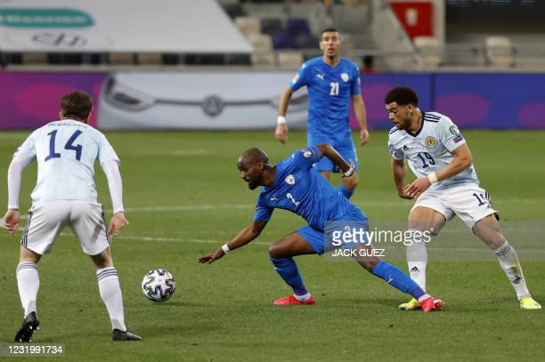 Israel's defender Eli Dasa is marked by Scotland's forward Che Adams during the 2022 FIFA World Cup qualifier group F football match between Israel...