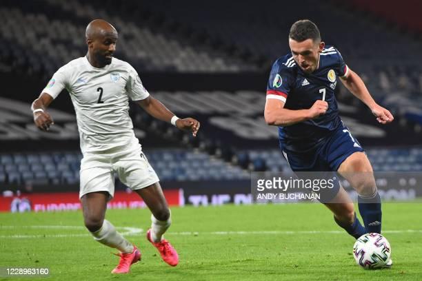 Israel's defender Eli Dasa vies with Scotland's midfielder John McGinn during the Euro 2020 playoff semi-final football match between Scotland and...