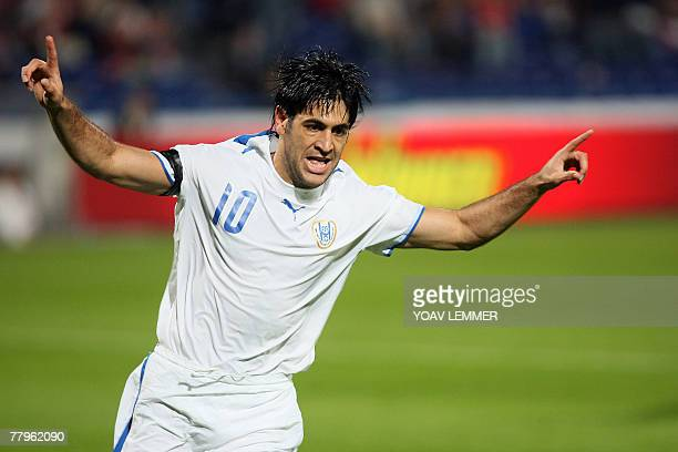 Israel's Elyaniv Barda celebrates after scoring the first goal in his team's Group E Euro 2008 qualifying football match against Russia at the Ramat...