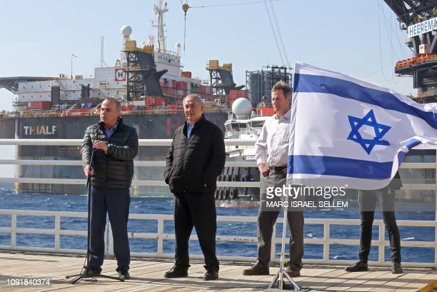Israel's Energy Minister Yuval Steinitz speaks as Prime Minister Benjamin Netanyahu and Noble Energy's Vice President for Major Projects George...