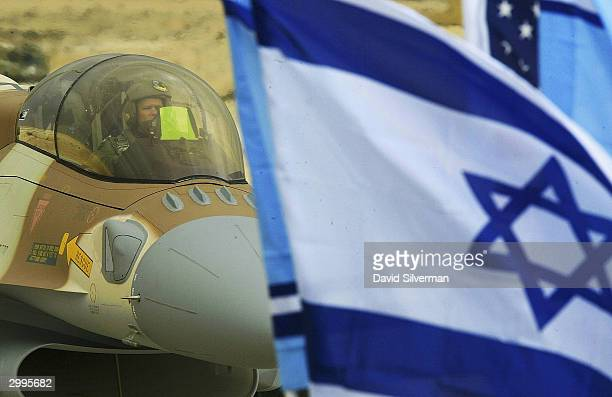 Israel's first F-16i jet fighter, piloted by an American pilot, taxis after landing February 19, 2004 at the Ramon Air Force Base in Israel's Negev...