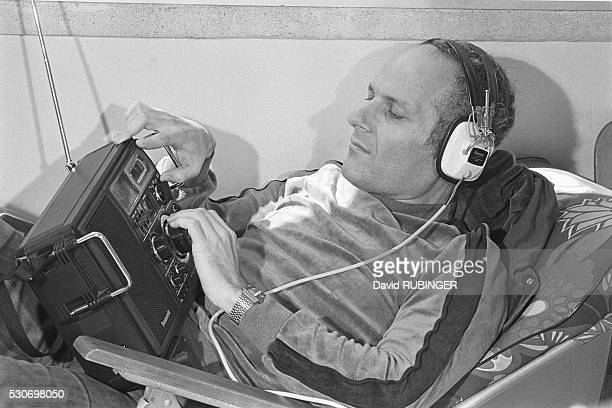 Israel's foremost radio ham Micky Gurdus listens to a radio broadcast
