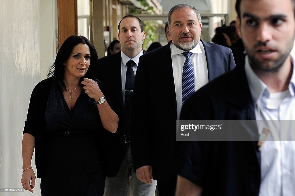 Israel's former Foreign Minister Avigdor Lieberman (2nd R) arrives for the opening hearing of his trial in which is he is facing charges of fraud and breach of trust, at Jerusalem Magistrates Court on February 17, 2013 in Jerusalem, Israel. Concerning incidents which took place more than a decade ago, Lieberman is accused of trying to advance the career of a former diplomat who relayed information to him about a since closed criminal investigation into his business dealings. Lieberman pleaded not guilty on all counts, expressing confidence that he will be cleared of all charges so that he may resume his role as Foreign Minister.