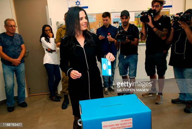 Israel's former justice minister Ayelet Shaked casts her ballot during Israel's parliamentary election at a polling station in Tel Aviv on September...