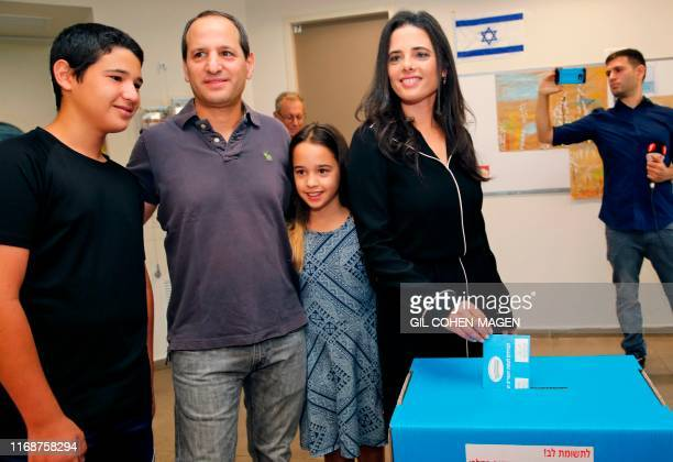 Israel's former justice minister Ayelet Shaked casts her ballot next to family during Israel's parliamentary election at a polling station in Tel...