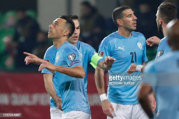 Israel's forward Eran Zehavy celebrates with teammates after scoring the team's first goal during the FIFA World Cup Qatar 2022 qualification...