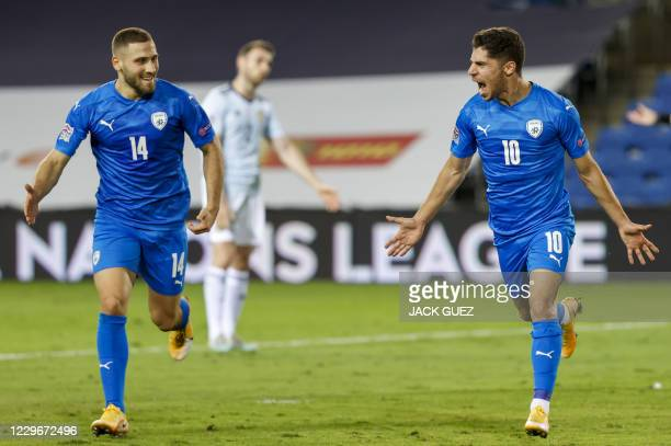 Israel's forward Manor Solomon celebrates after scoring during the UEFA Nations League B Group 2 football match between Israel and Scotland at the...