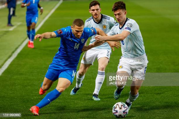 Israel's forward Shon Weissman is marked by Scotland's defender Kieran Tierney during the 2022 FIFA World Cup qualifier group F football match...