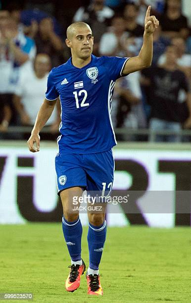 Israel's forward Tal Ben Haim celebrates after scoring during their World Cup 2018 qualification match between Israel and Italy at the Sammy Ofer...