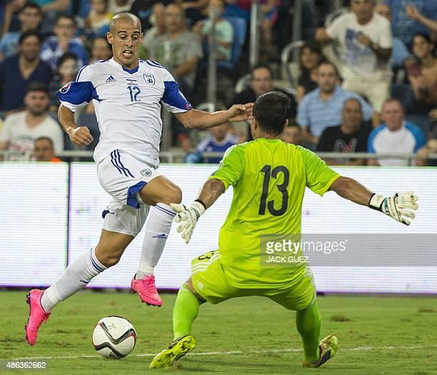 Israel's forward Tal Ben Haim II vies for the ball with Andorra's goalkeeper Ferran Pol during their Euro 2016 qualifying football match at the Sammy...