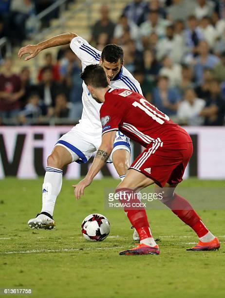 Israel's forward Tomer Hemed controls the ball as Liechtenstein's midfielder Sandro Wieser defends during the World Cup 2018 qualification football...