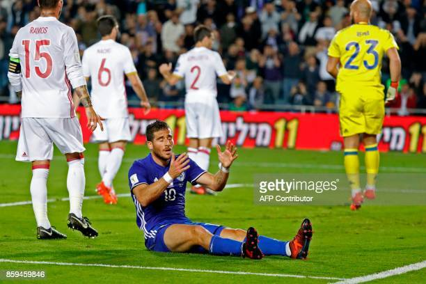 Israel's forward Tomer Hemed reacts during the Russia 2018 FIFA World Cup European Group G qualifying football match between Israel and Spain at...