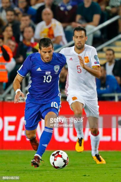 Israel's forward Tomer Hemed vies for the ball with Spain's Sergio Busquets during the Russia 2018 FIFA World Cup European Group G qualifying...
