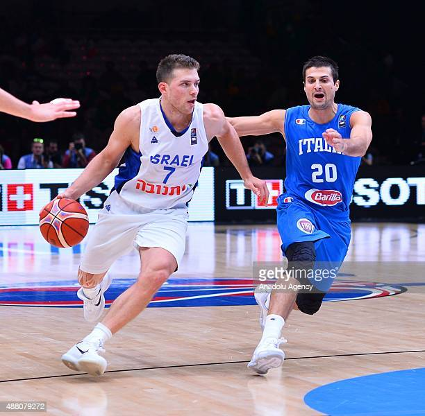 Israel's Gal Mekel vies against Italy's Andrea Cinciarini during the EuroBasket 2015 Round of 16 match between Israel and Italy at the Pierre Mauroy...