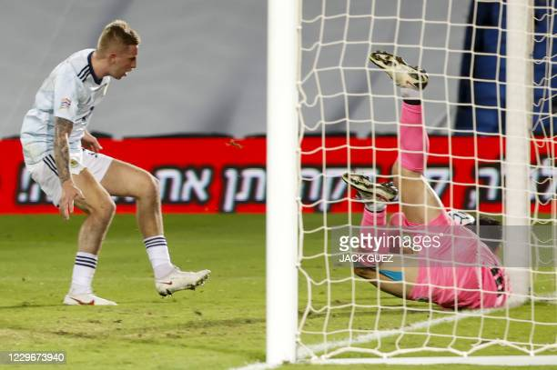 Israel's goalkeeper Ofir Marciano dives to make a save during the UEFA Nations League B Group 2 football match between Israel and Scotland at the...