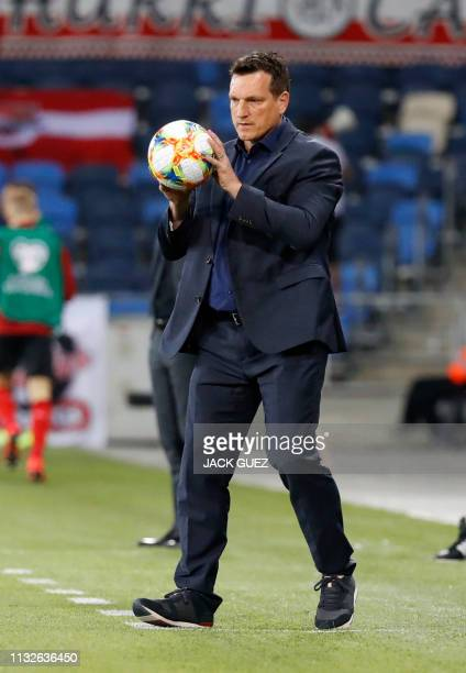 Israel's head coach Andi Herzog returns the ball to the field during the Euro 2020 Group G football qualification match between Israel and Austria at...