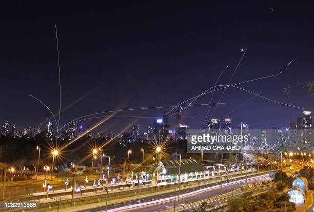 Israel's Iron Dome air defence system intercepts rockets above the coastal city of Tel Aviv on May 15 following their launching from the Gaza Strip...