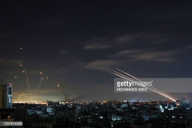 Israel's Iron Dome missile defence system intercepts rockets fired by the Hamas movement from Gaza city towards Israel early on May 16, 2021. -...