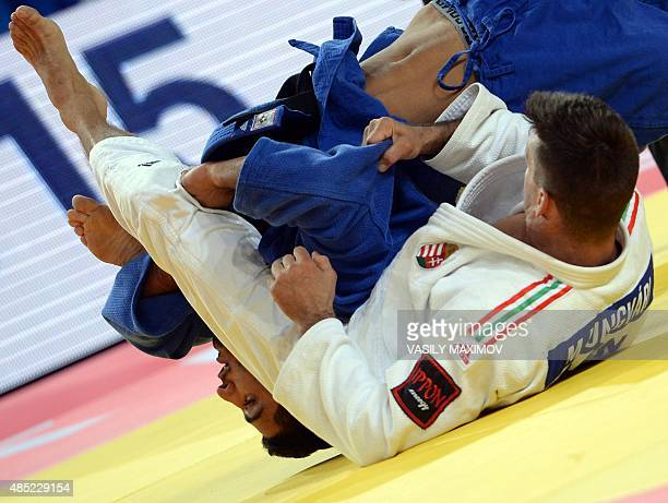 Israel's judoka Tohar Butbul competes with Miklos Ungvari from Hungary during the mens qualification match in the 73 kg category at the the IJF Judo...