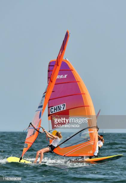 Israel's Katy Spychakov and China's Lu Yunxiu compete in the women's windsurfing RSX class competition during a sailing test event for the Tokyo 2020...